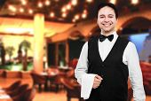 stock photo of waiter  - Young waiter at the restaurant - JPG