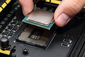 stock photo of processor socket  - Installing modern central processor unit into motherboard - JPG