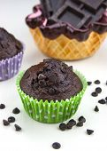 picture of chocolate muffin  - Close up of chocolate muffins on a white table with a lot of chocolate - JPG