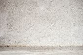 pic of floor covering  - stucco white wall - JPG