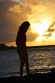 foto of hawaiian girl  - A young girls profile in silhouette against an Oahu sunset - JPG