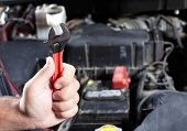 pic of auto garage  - Mechanic working in auto repair garage - JPG