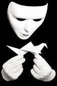 stock photo of shadoof  - White theatrical mask and paper japanese crane isolated on black - JPG