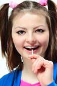 stock photo of lolita  - Portrait of a happy young girl with a lollipop on white background - JPG