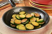 picture of sauteed  - Sauteed organic zucchine squash in a frying pan - JPG