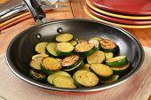 foto of sauteed  - Sauteed organic zucchine squash in a frying pan - JPG