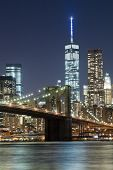 picture of freedom tower  - The New York City skyline at night w Brooklyn Bridge and Freedom tower