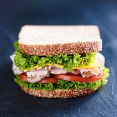 pic of deli  - deli meat turkey sandwich on slate surface - JPG