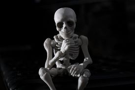 stock photo of thinkers pose  - A skeleton sitting pose as a thinker - JPG