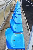 stock photo of grandstand  - Empty blue seats in stadium - JPG