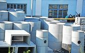 pic of septic  - Concrete circle pit and pipe block on factory yard - JPG