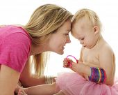 stock photo of adoration  - An adoring mother watching closely as her 2 - JPG
