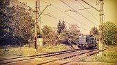 image of locomotive  - Retro toned picture of a locomotive on railway crossing old film style - JPG