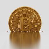stock photo of coin slot  - Bitcoin Drops Into A Slot - JPG