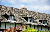 stock photo of timber  - Rooftop windows in a traditional white timbered former cottage hospital along East Street Pembridge Herefordshire England UK Western Europe - JPG