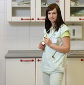 stock photo of icu  - Portrait female nurse in ICU in the green uniform - JPG