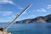 picture of lifeguard  - Lifeguard on a wooden ladder above the sea - JPG