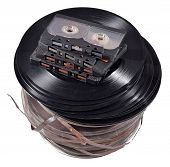 stock photo of magnetic tape  - Old vintage bobbins vinyl records and cassette tapes on a white background - JPG