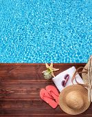 stock photo of water bird  - Swimming accessories on wooden mole placed next to water surface of pool - JPG