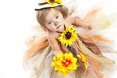 picture of scarecrow  - Adorable toddler dressed as a scarecrow and looking up at the camera - JPG