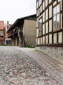 image of old stone fence  - old historical buildings in old town of Kuldiga Latvia - JPG