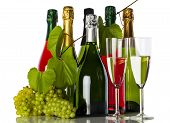 foto of flute  - Champagne bottles with grapes and champagne flutes - JPG