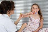 foto of ten years old  - Smiling young girl of ten years old brushing teeth - JPG