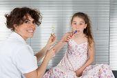 image of ten years old  - Smiling young girl of ten years old brushing teeth - JPG