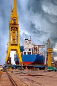 stock photo of shipbuilding  - Ships and cranes in shipyard of Gdansk Poland - JPG