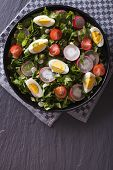 picture of sorrel  - Fresh salad with egg radishes and sorrel close up on the table - JPG