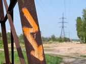 stock photo of power transmission lines  - Power transmission line with high voltage sign - JPG