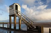 picture of early morning  - The safety hut on Holy Island causeway in the early morning sunlight - JPG