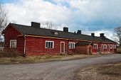 pic of manor  - The old Finnish manor of red logs against the background the blue sky - JPG