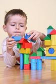 foto of children playing  - four years boy playing with colorful wooden blocks - JPG