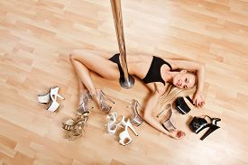 picture of strip tease  - Young Slim Pole Dance Blond Woman smile - JPG