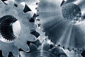 stock photo of duplex  - cogwheels and gear parts titanium and steel - JPG