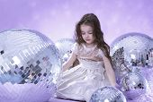 Beautiful girl with discoballs. poster