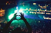 Постер, плакат: Heart Shaped Hands At Concert Loving The Artist And The Festival Music Concert With Lights