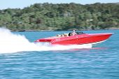 picture of outboard engine  - a high speedy red yacht in the ocean  - JPG