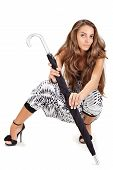 pic of harem  - Young pretty lady in harem pants posing with black umbrella on white - JPG