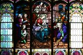 picture of stained glass  - epiphany scene on a church central window - JPG