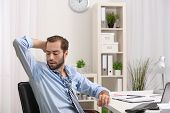 Young man sweating in office poster