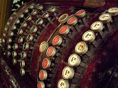 pic of shilling  - Close up of the buttons on an old cash register - JPG