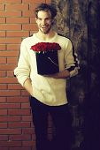 Bearded Muscular Man With Sexy Body Holds Red Rose Box poster