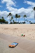 picture of boogie board  - Boogie board and beach balls on a tropical beach