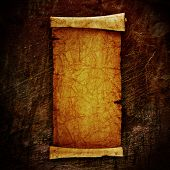 scroll of old parchment, on grunge wall poster