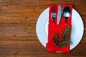 Christmas Plate And Appliances On A Wooden Table Top View With Copy Space. poster
