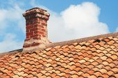 Tile Roof With Brick Chimney