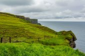 Beautiful Landscape Of The Irish Countryside, Cliffs And The Sea Along The Coastal Walk Route From D poster