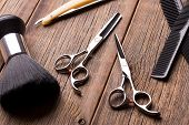 Barber Tool On A Wooden Table. Scissors, Comb For Hair And A Razor Close-up. Hairdressing Tool Kit.  poster